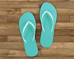 Flip flops on a wooden background