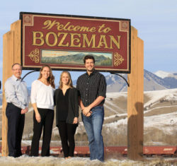 Dentists in front of Welcome to Bozeman sign
